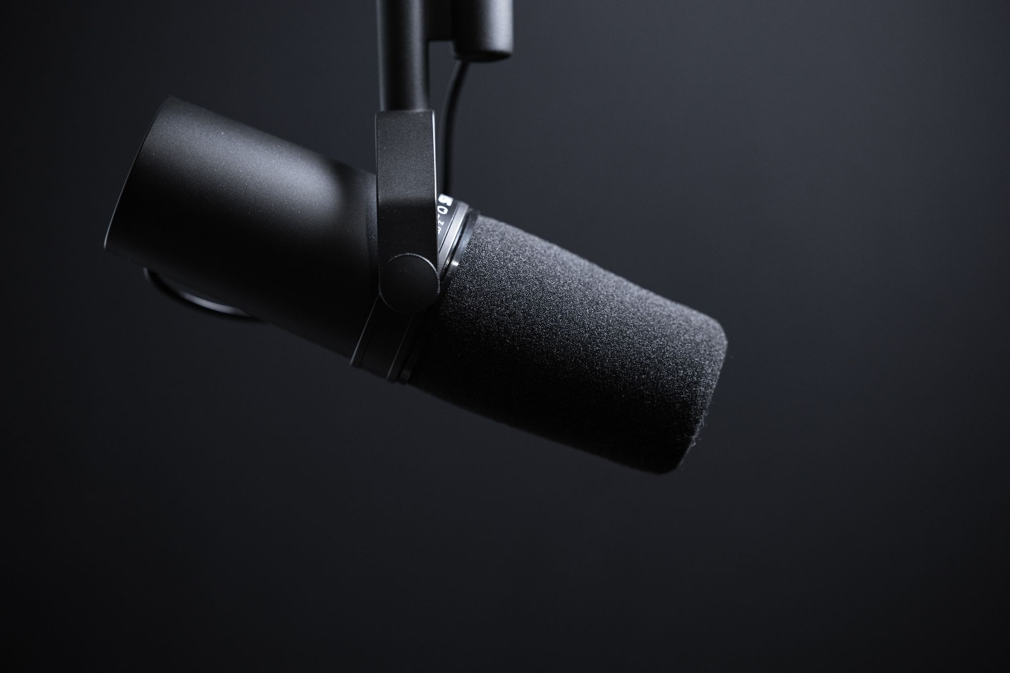 Dynamic podcasting microphone on black